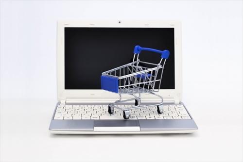 PCとショッピングカートのイメージ